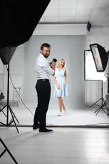Beautiful model posing for professional photographer in studio