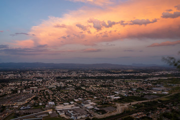 Stunning reddish sunset on Valence city with mountains on the background in french Rhone-Alpes region. Top view.