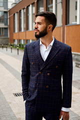 Confidence and charisma. Stylish young man in full suit.