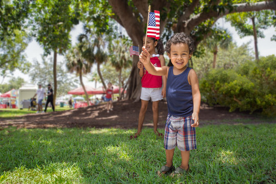 Siblings at the park celebrate the 4th of July.