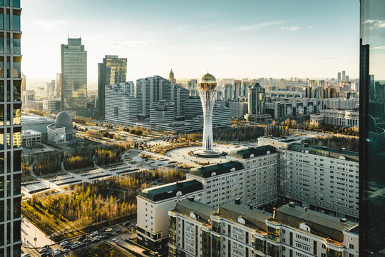 Sunset view towards Bayterek tower and hous of ministries in Astana Kazakhstan on a clear day