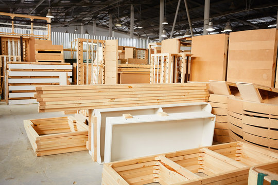 Industrial factory. Furniture production at woodworking enterprise. Wood processing manufacture.