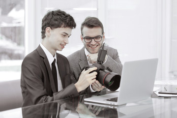 qualified photographers choose photos to upload files to their laptops