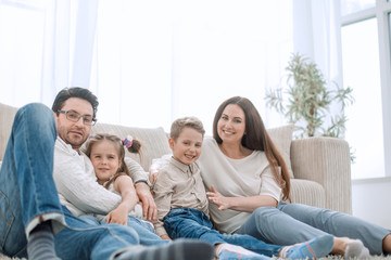 happy family resting in their comfortable living room