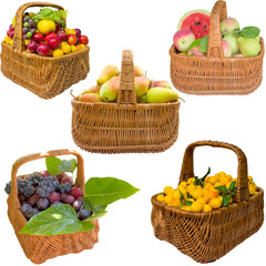 Autumn basket with fruit isolated on a white background.