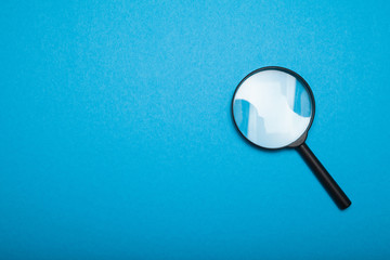 Magnifying glass lens, investigation concept. Copy space for text. Search and zoom.