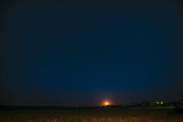 Moonrise Above Belarusian Village In Eastern Europe. Belarusian