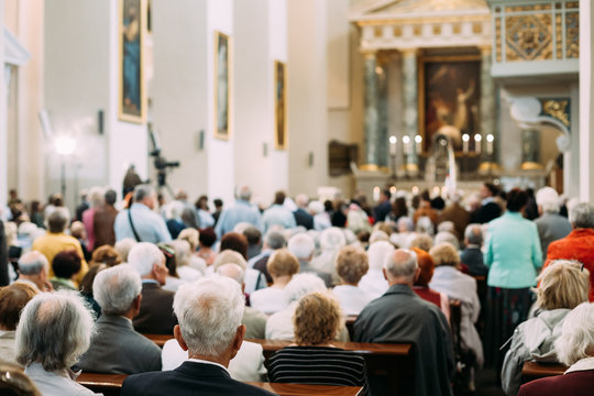 Group Of Old People Parishioners in Cathedral Church