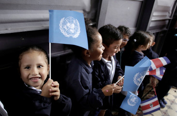 School children wait for the arrival of U.N. Secretary General Antonio Guterres during his visit to the United Nations School in San Jose, Costa Rica