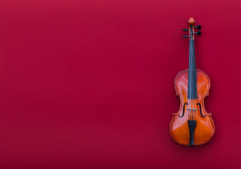 violin on red isolated background