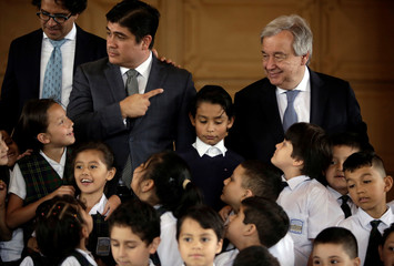 Costa Rica's President Carlos Alvarado, and U.N. Secretary General Antonio Guterres, prepares to a picture with schoolchildren during their visit to the United Nations School in San Jose