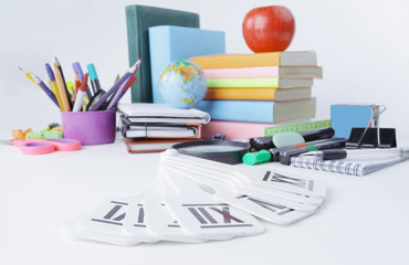 image of variety of school supplies on white background