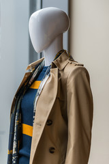 Fashion mannequin with trench coat