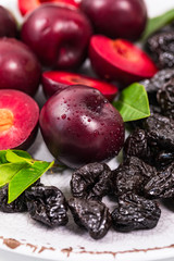 Dried Plums Pitted Prunes and Fresh Plums Background. Selective focus.