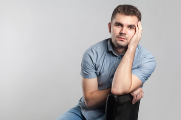 Puzzled serious man sit and thinking