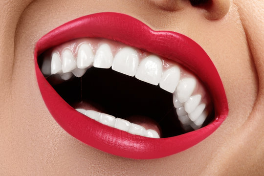 Dental photo. Macro Happy Female Smile with Healthy White Teeth. Red Lips Make-up. Stomatology Treatment, Whitening