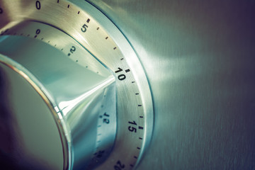 10 Minutes - Analog Chrome Kitchen Timer Placed On A Refrigerator