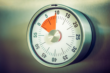 10 Minutes - Analog Kitchen Timer Placed On A Refrigerator