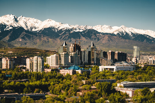 City landscape on a background of snow-capped Tian Shan mountains in Almaty Kazakhstan