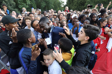 France's defender Benjamin Mendy is congratulated by supporters during during a reception at the Elysee Presidential Palace, in Paris