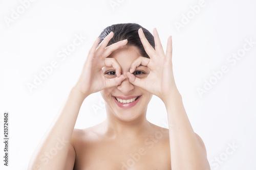 Beautiful smiling woman with natural makeup making