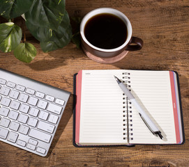 Opened Notebook on a Wooden Desktop