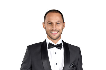 Serious man in a tuxedo on a white background.