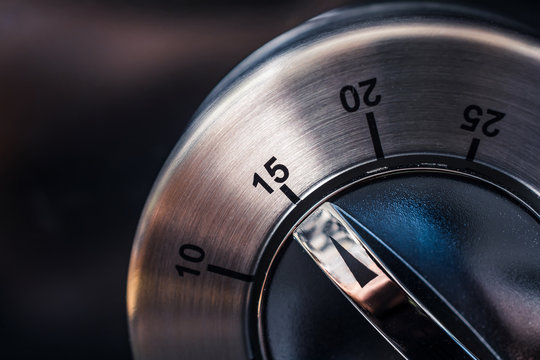 15 Minutes - Macro Of An Analog Chrome Kitchen Timer With Dark Background