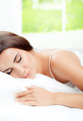 Young woman sleeping at bedroom