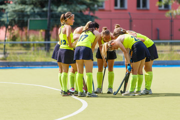 Women field hockey team before start of the game discussing strategy