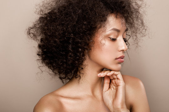 Fashion studio portrait of beautiful african american woman with perfect smooth glowing skin