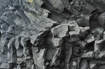 The texture of the basalt stone on the Black Beach in Iceland