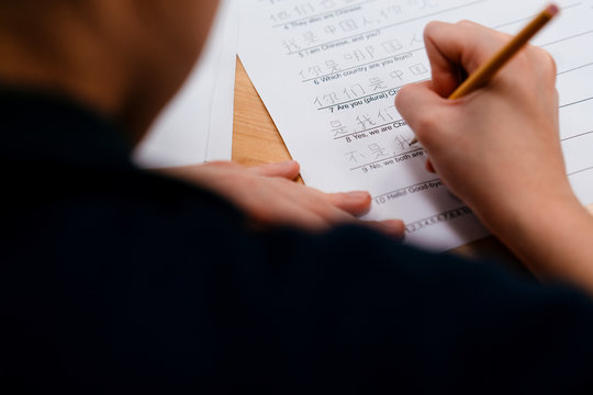 student works on Chinese worksheet