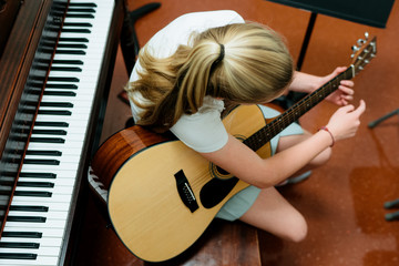 music student practices guitar in practice room