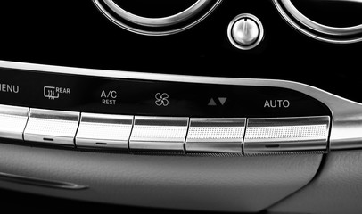 Air conditioning button inside a car. Climate control AC unit in the new car. Modern car interior details. Car detailing. Black and white