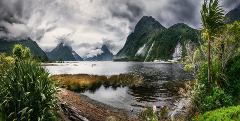 Wild Weather at Milford Sound -Panoramic view at Freshwater Basin towards the fjord's entry, with Bowen falls and Mitre Peak in Fiordland National Park, New Zealand