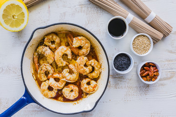 Giant prawns prepared for teriyaki with soba noodles.