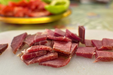 Sliced domestic ham on a kitchen table.