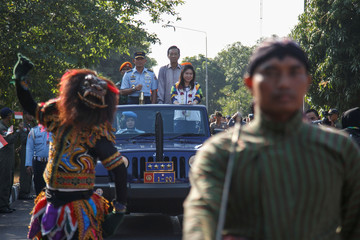 Asian Games torch arrives in Indonesia from India ahead of the 18th Asian Games in Yogyakarta