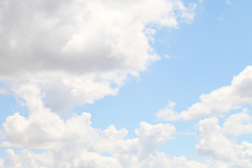 Blue sky with white beautiful clouds. The texture of natural phenomena, cloudiness on a clear sunny day.