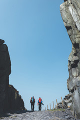 Silhouette of two backpackers visiting the ancient Dinorwic Quarry at Snowdonia National Park in North Wales