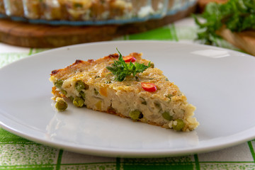 piece of vegetable pie with green peas