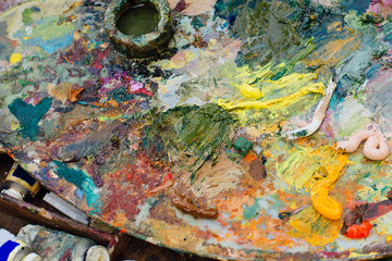 Close up palette with oil paints.
