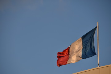 French flag in blue sky