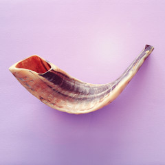 Rosh hashanah (jewish New Year holiday) concept. SHOFAR (HORN) Traditional symbol.
