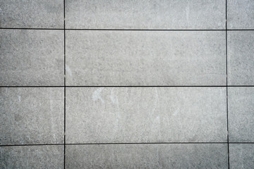 grey stones walls on office building - full frontal