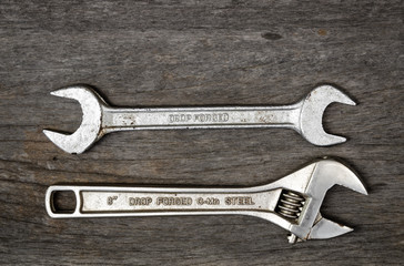 old wrench steel tools on aging wood background