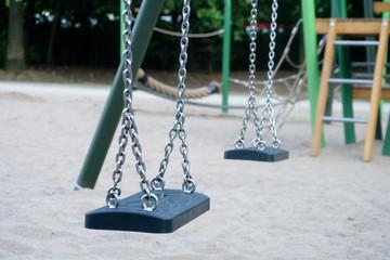Children Playground - swing in focus