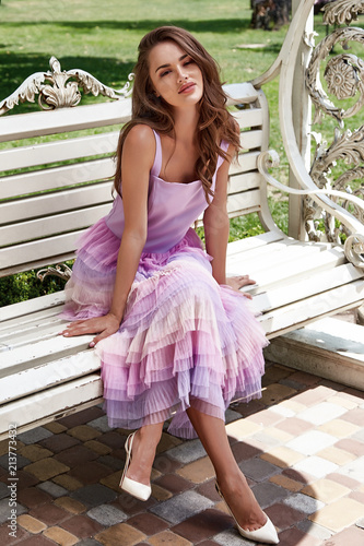 96538b617e19 Sexy beauty woman pretty cute face makeup cosmetic long blonde hair fashion  glamour model wear designer pink silk dress gentle seat in the park on  swing ...