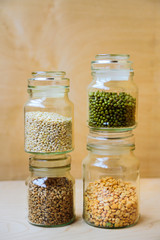 Beans, peas, wheat and pearl barley in jars
